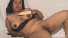 Chubby Asian lady with saggy tits and a big booty teases with a dildo