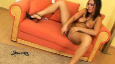 Hot brunette with a fine body uses beads and dildos on her twat