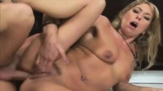 Inked blonde slut gets her holes plugged while bent over the counter