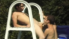 Two wonderful gay twinks have anal sex by the pool and under the sun
