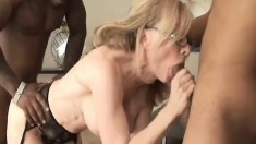 Busty blonde mature lady Nina Hartley takes on two dark shafts at once