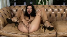 Sultry brunette unpeels her leopard tights to stroke a gold dildo between her legs