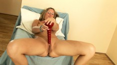 Delightful blonde finds herself alone and drives her twat to pleasure