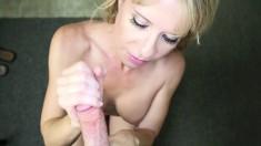 Naughty blonde mom with big boobs gives a splendid handjob POV style