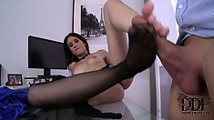 She gets him hard with her stocking covered feet, and cums on them
