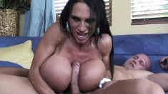 Huge breasted brunette milf seduces a young guy to fuck her wet pussy