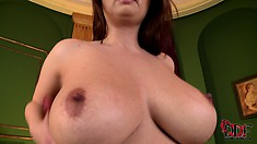 Chubby babe with massive tits rubs her cunt with a pearl necklace