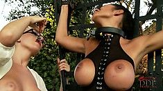 Busty brunette slave in latex is strung up and tortured by her mistress
