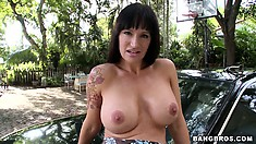 Stacked Milf strips her attractive dress and reveals her lovely wet pussy