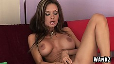 Stacked brunette with sexy long legs Crissy Moran satisfies her urges with a pink dildo