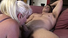 Nasty chubby granny, with white hair, has a cock to take care of
