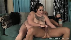 Fat goth uses her gianormous tits to play with her lover's shaft
