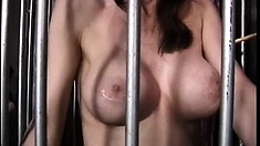Gorgeous brunette sex slave suffers at the hands of her mistress