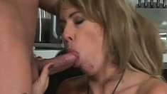 Blonde mom Tara Romain has a young guy fucking her holes in the kitchen