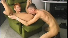 Naughty redhead cougar with sexy tits fucks a hard cock in the office