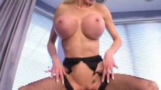 Busty blonde lady in fishnet stockings wildly fucks a young stud's cock
