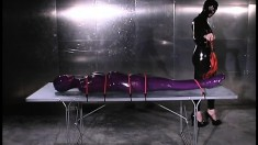 Freaky lesbian mistress with a latex fetish immobilizes her pet
