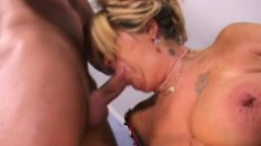 Stacked mature blonde in black stockings gets pounded by a young guy