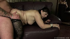 She enjoys the pussy pounding action on the sofa before licking his ass
