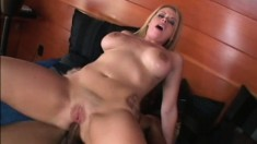 Stacked blonde Daphne Rosen takes a massive black cock deep in her ass