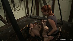 Curvy brunette chick in bondage gets teased by her hot mistress