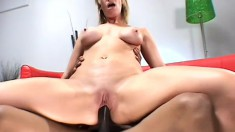 Busty blonde attacks his black rod and sucks and fucks him into heaven
