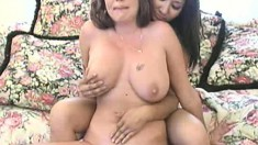 Two big breasted hotties engage in lesbian action and ride the sybian