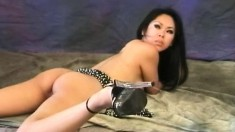 Miki spreads her hot body across the floor and exposes her juicy holes