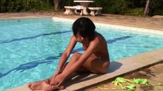 Delightful Asian teen Katherine reveals her fabulous body in the pool