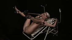 Blonde slave gets toyed in a cage and is pulled out to be tortured and fucked