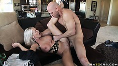Lying on her back she gets drilled deep before welcoming his cum on her huges tits