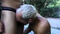 Tattooed blond man enjoys sucking this young Romeo's thick prick