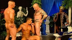 Four handsome and muscled hunks enjoying lots of sucking and fucking