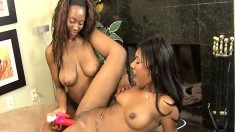 Sexy black lesbians lick their clits and then vibrate each other