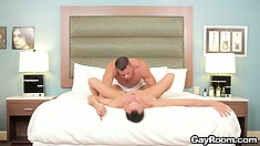 Buff hunk deep-throats a twink's twitching cock before fucking him