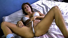 Hot Latina milf Tara Holiday seductively displays her heavenly ass and her superb tits