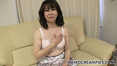 Sexy Asian cougar Hitomi hides underneath her clothes a hot body craving for attention
