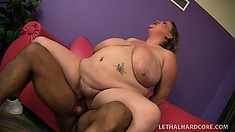 Her huge boobs bounce and jiggle as she rides his big black prick with excitement