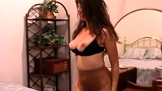 Busty Milf masturbates in her black nylon stockings