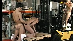 Three gay dudes take a break from work and satisfy their desires in the warehouse
