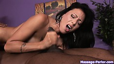 Horny masseuse munches black cock and the do sixty-nine on table