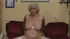 Lustful granny in white lingerie has a young stud fulfilling her needs