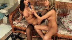 Blonde and brunette lesbians use a few sex toys to make each other cum